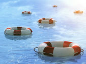 Lifebuoys, floating on waves — Stock Photo