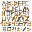 Alphabet from wooden boards and bark - Stock Photo