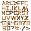 Alphabet from wooden boards and bark — Stock Photo