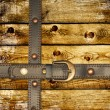 Old wooden boards and leather belt — Stock Photo