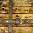 Old wooden boards and leather belt - Stock Photo