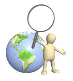 3d puppet with magnifier and Earth — Stock Photo