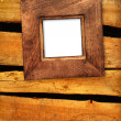 Old frame on wooden wall — Stock Photo