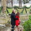 Romantic couple in love having a date in the Luxembourg garden — Stock Photo