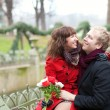 Romantic couple in a park at spring, dating — Stock Photo