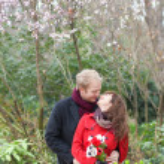 Romantic couple having a date in a beautiful garden — Stock Photo
