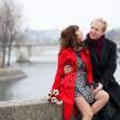 Stock Photo: Dating couple at Parisiembankment