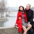 Dating couple at the Parisian embankment at misty day — Stock Photo