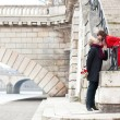 Stock Photo: Beautiful romantic couple kissing on a Parisian embankment at sp