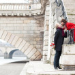 Beautiful romantic couple kissing on a Parisian embankment at sp — Stock Photo