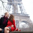 Romantic couple in love dating near the Eiffel Tower at spring o — Stock Photo