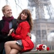 Happy couple in love dating near the Eiffel Tower at spring or a — Stock Photo