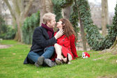 Romantic couple in love sitting on the grass — Stock Photo
