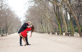 Dating couple dancing in a park — Stock Photo