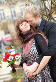 Dating couple with beautiful bright flowers — Stock Photo
