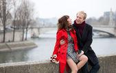 Dating couple at the Parisian embankment — Stock Photo