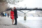 Romantic couple in love dating near Pont des Arts in Paris — Stock Photo
