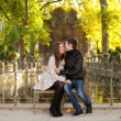 Young beautiful couple in the Luxembourg garden at fall. Paris, - Stock Photo