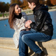 Young romantic couple near water at warm sunny autumn day — Stock Photo