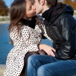 Stock Photo: Romantic couple outdoors, kissing
