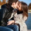 Romantic couple kissing in autumn park — Stock Photo