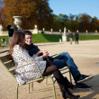 Dating couple in the Luxembourg garden of Paris — Stock Photo #9313770