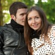 Young happy couple outdoors at fall — Stock Photo #9314427
