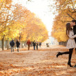 Young beautiful couple in the Luxembourg garden at fall - Stok fotoğraf