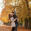 Young beautiful couple in the Luxembourg garden at fall. Paris, — Stock Photo