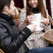 Happy young couple in a Parisian Street cafe — Stock Photo #9314811