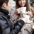 Happy young couple in a Parisian street cafe — Stock Photo