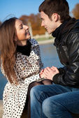 Happy young couple outdoors at sunny autumn day — Stock Photo