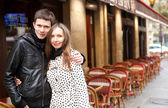 Young romantic couple in Paris, near a street cafe — Stock Photo