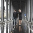 Bad weather in Paris. Couple on the bridge Bir-Hakeim at rainy w - Stock Photo
