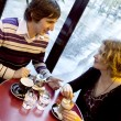 Happy couple in a Parisian cafe at rain — Stock Photo