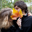 Secret kiss. Dating couple at fall — Stock Photo