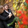 Dating couple at fall — Stock Photo