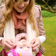 Young mother and baby daughter having fun outdoors — Stock Photo #9407853