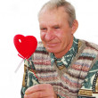 Senior keeping fake heart. — Stock Photo