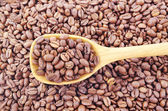 Coffee beans in a spoon. — Stock Photo