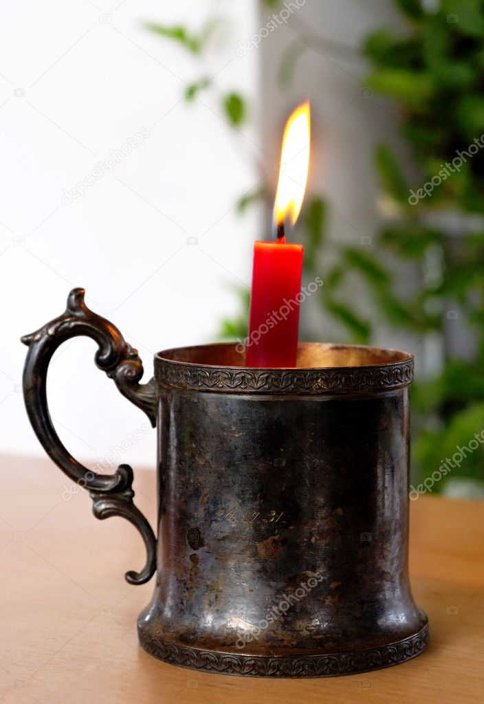 Candlestick with flaming candle on the table. — Lizenzfreies Foto #10147895