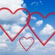 Fluffy clouds and hearts. — Stock Photo #10260421