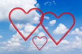 Fluffy clouds and hearts. — Stock Photo