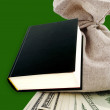 Black book and dollars. — Stock Photo