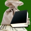 Stock Photo: Black book and dollars.
