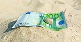 Euro on sand. — Stockfoto