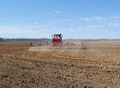 Tractor on a field. — Stock Photo