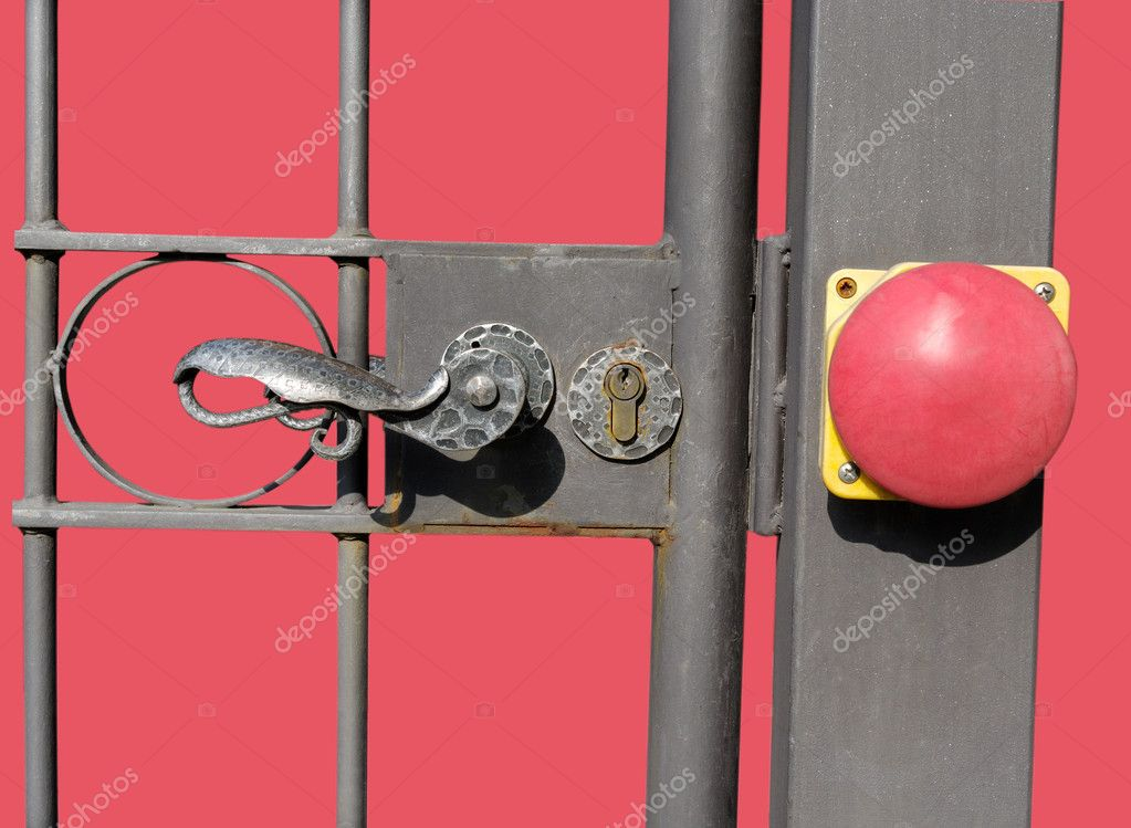 Part of gate with red button isolated on the surface. — Stock Photo #10615643