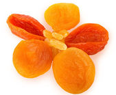 Raisins and dried apricots on a white background — Stock Photo