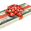 Gift of money, dollars bank notes, tied a red ribbon with a bow — Stock Photo
